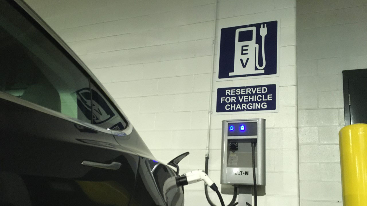 An electric car charges in the Halifax Central Library parking garage. A new business in Dartmouth, All EV, will be selling used electric cars, which could make them more affordable for the average Nova Scotian.