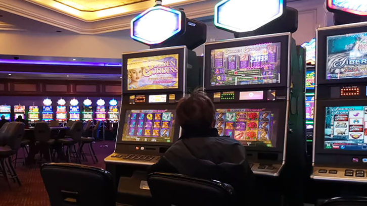 A gambler sits at a slot machine at Casino Nova Scotia.