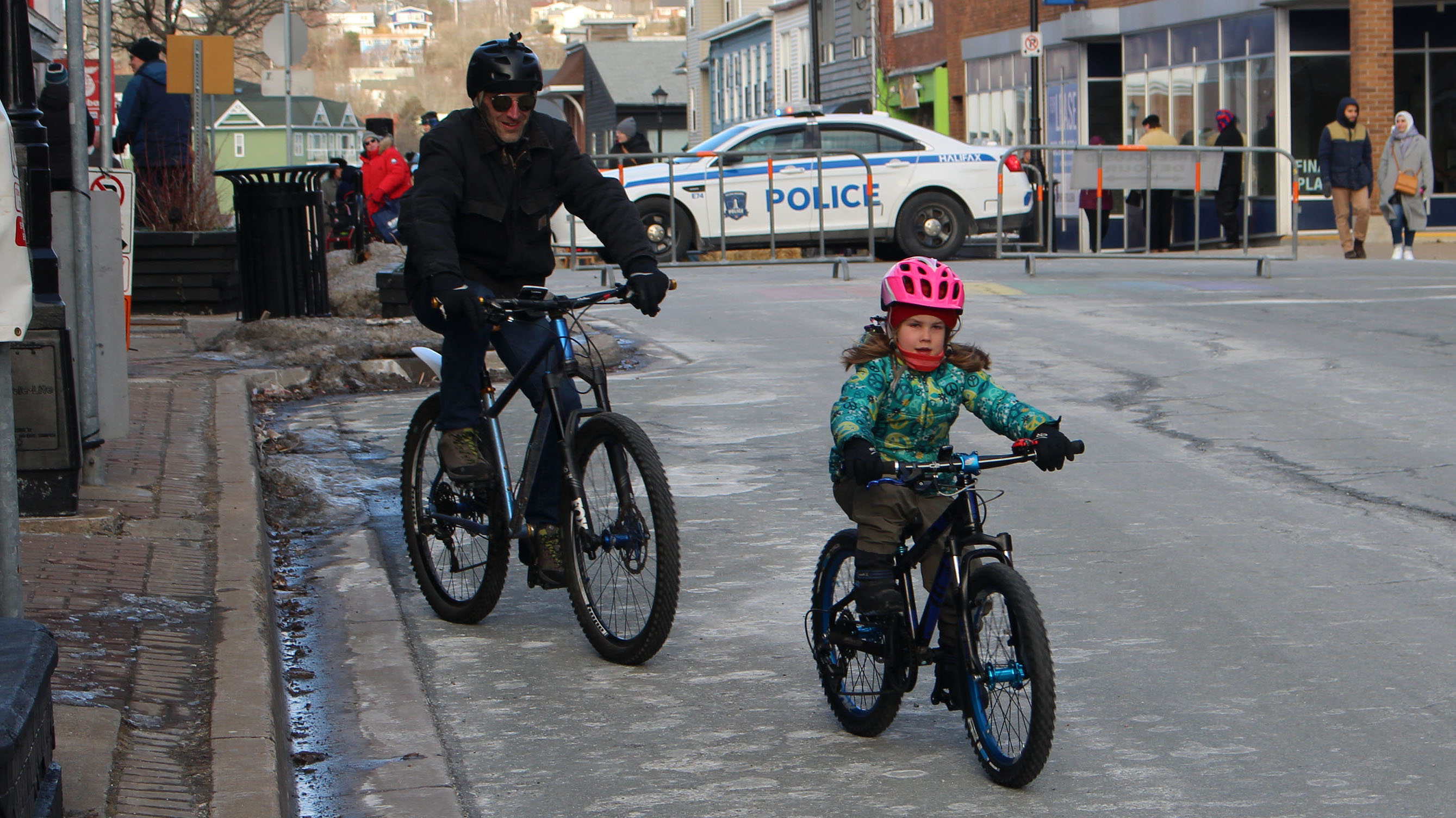 Marc Rickard (left) bikes with his daughter Ivy (right) down Portland Street in Dartmouth. They were out for the first day of Winter Bike Week in Halifax, which started Feb. 8.