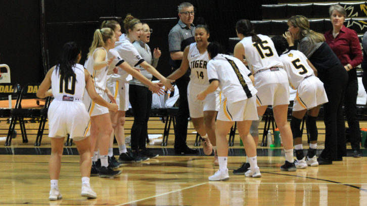 The Dalhousie women's basketball team cheers on the starting lineup as they step onto the court.
