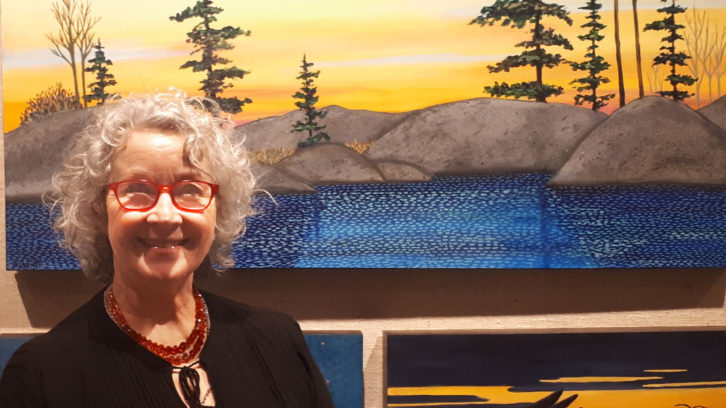 Shelagh Duffett stands in front of her paintings in the Chase Gallery in Halifax on Saturday.