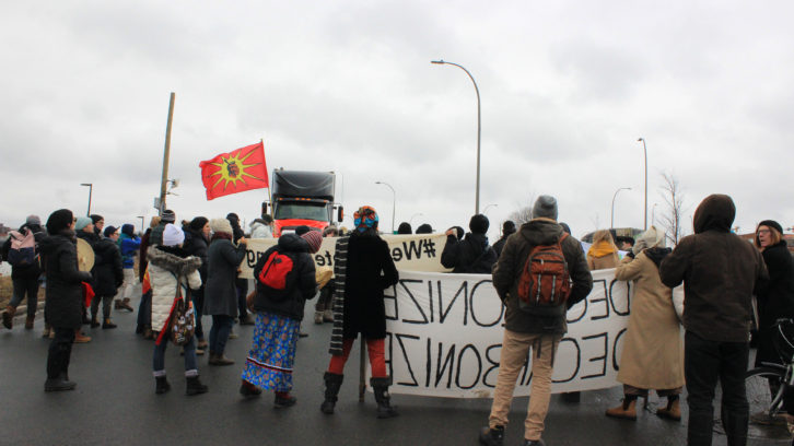 More than 150 people stood on Bayne Road in Halifax, blocking cargo trucks in solidarity with Wet'suwet'en Indigenous groups in B.C.