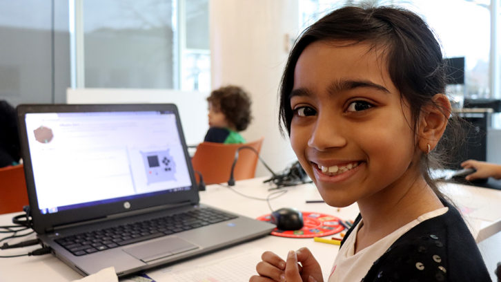 Kierra D'penha, 8, coded a message for astronauts at the Halifax Central Library on Tuesday.