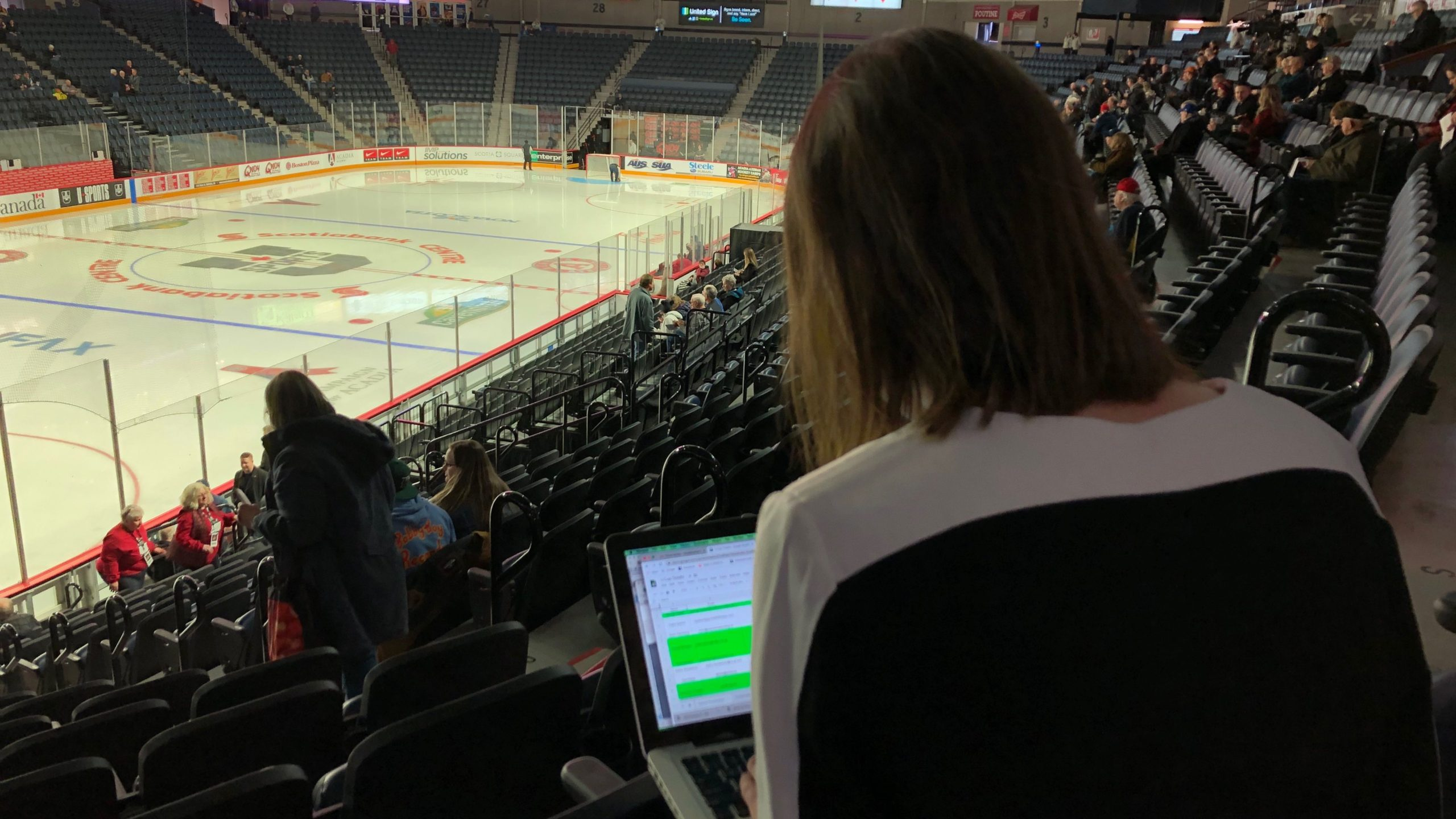 Before the puck drops, Rhéa Koivu catches up on emails.