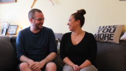 Scott Pyke and Erica Brewster sitting in Pyke's living room.