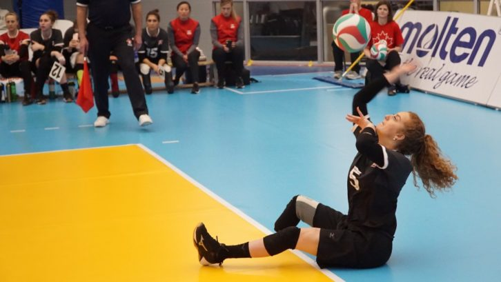 Payden Olsen serves in the final 2020 Paralympic sitting volleyball qualifier.