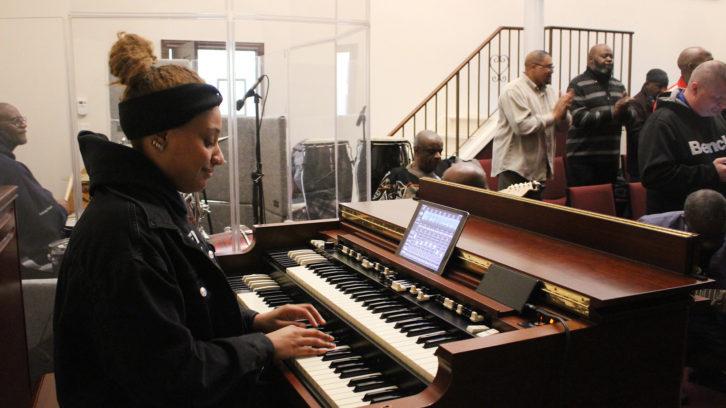 Reeny Smith sits at the church's organ