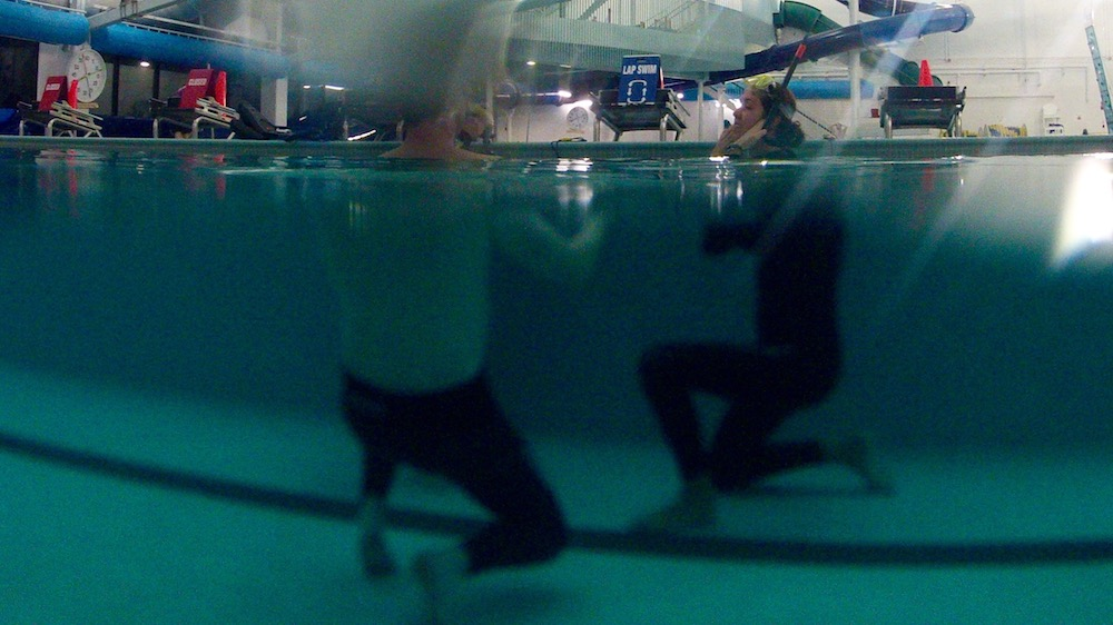 Madison Stewart (right) adjusts her snorkel mask at a freediving learning session in Dartmouth on March 4.