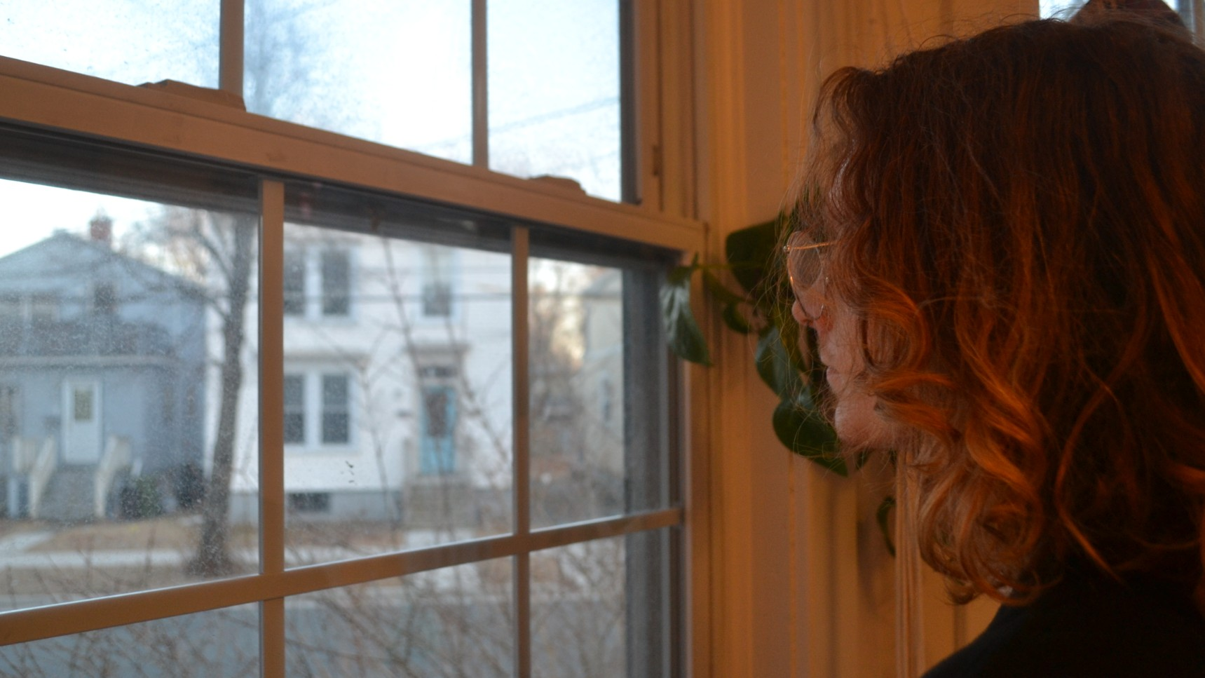 Luke Cameron looks out his window in Halifax. Nova Scotians are encouraged to practice social distancing to prevent the spread of COVID-19.