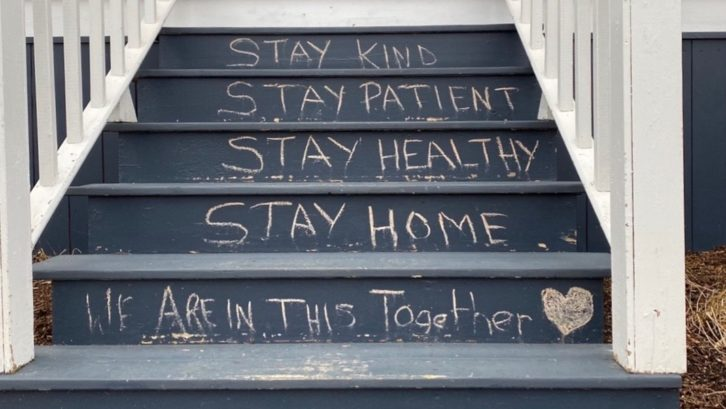 A message about staying home and safe on the front steps of a house in south-end Halifax.