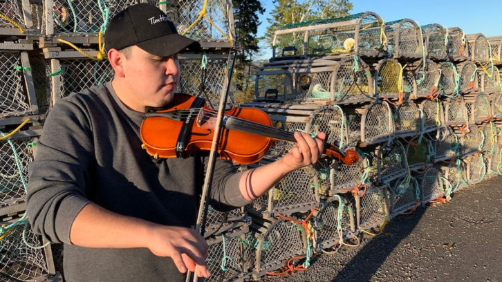 Morgan Toney plays his fiddle at the wharf beside Wagmatcook Elders Centre in Wagmatcook First Nation, one of the two communities he calls home.