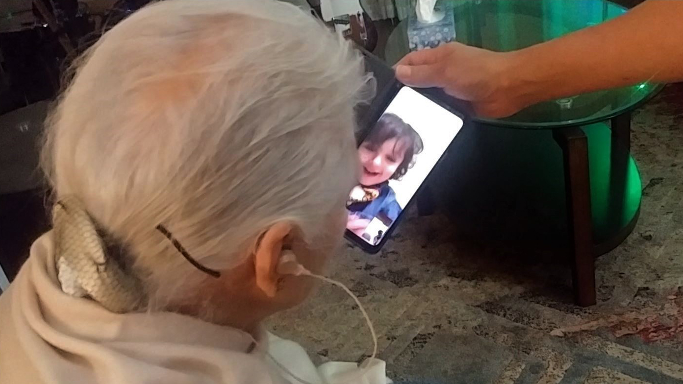 A Toronto-area senior video-chats with her grandson.