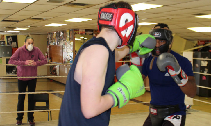 Bridget Stevens coaches two of her boxers, John-Michael Forrestall and Andrew Thomas at her gym.