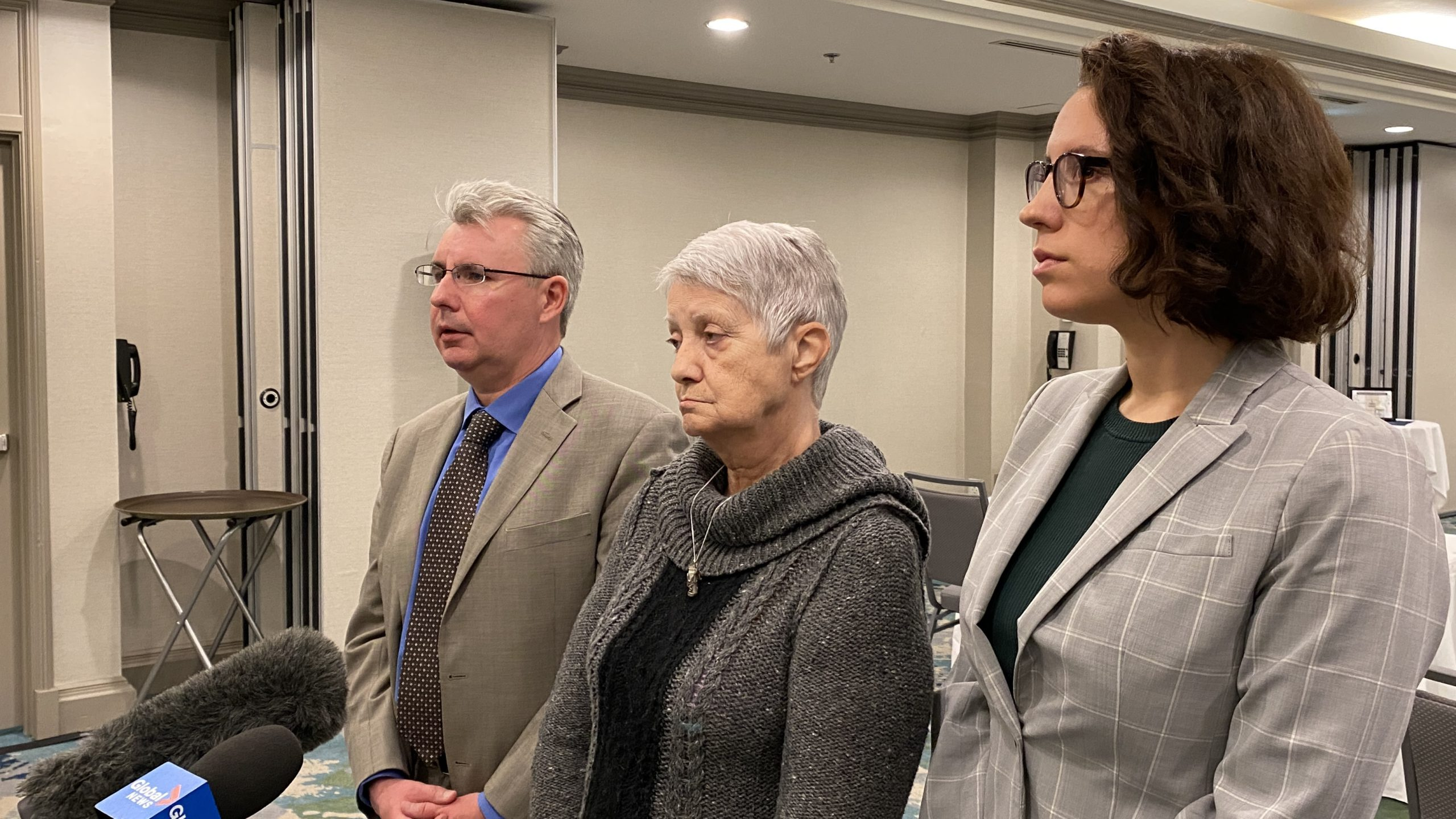 Jeannette Rogers (centre) speaks to media with her lawyers, Jason Cooke and Ashley Hamp-Gonsalves