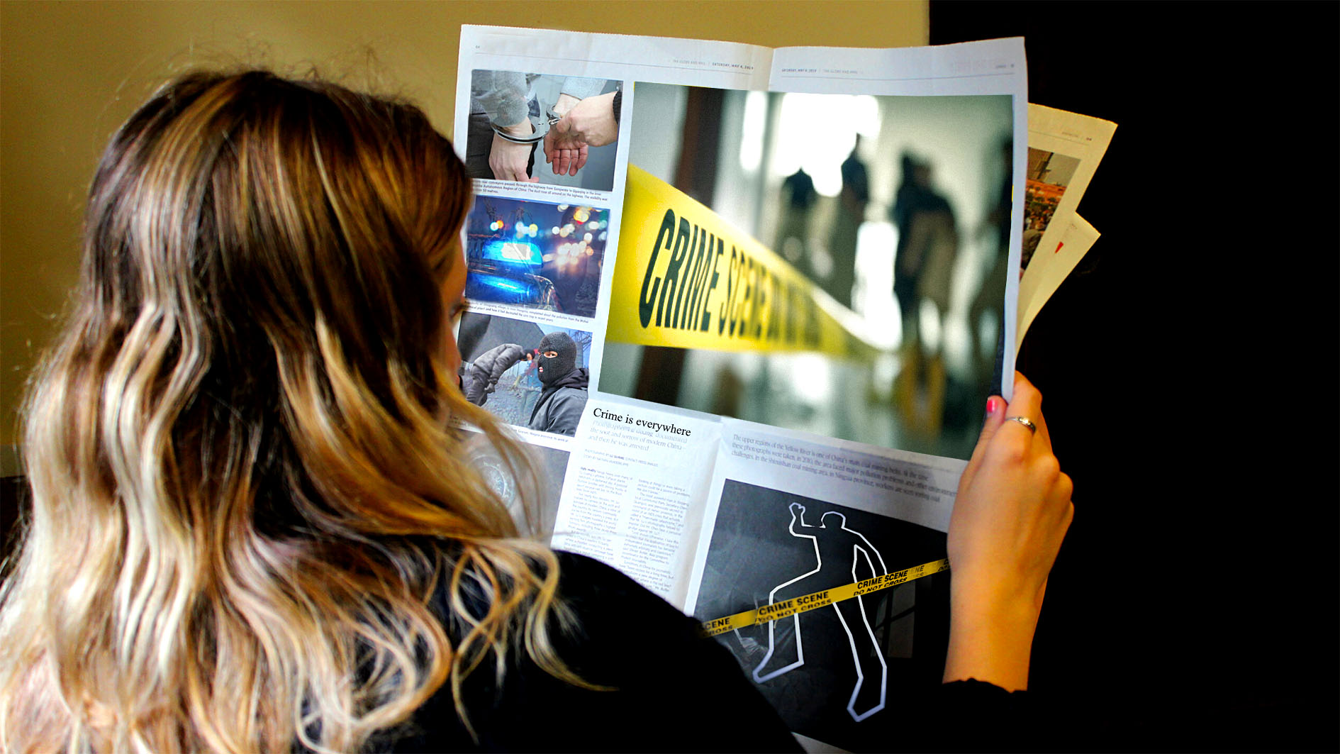 A reader looks over a newspaper full of crime in this photo illustration.