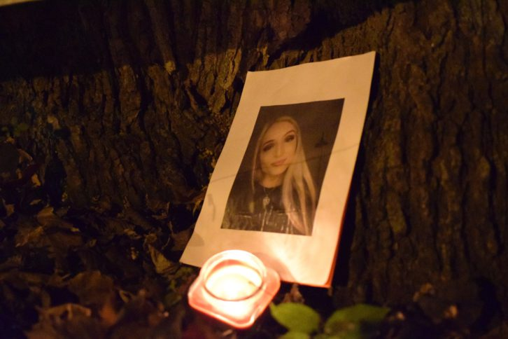 A photo of Rukia Isis Bemer sits under a tree in Raymond Taavel Park.