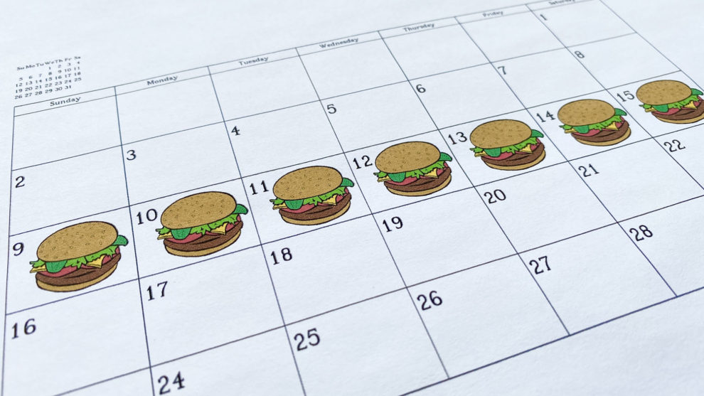Burgers are seen on a calendar in this photo illustration.