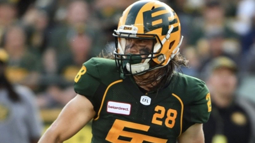 Jordan Hoover playing in the Canadian Football League at Edmonton