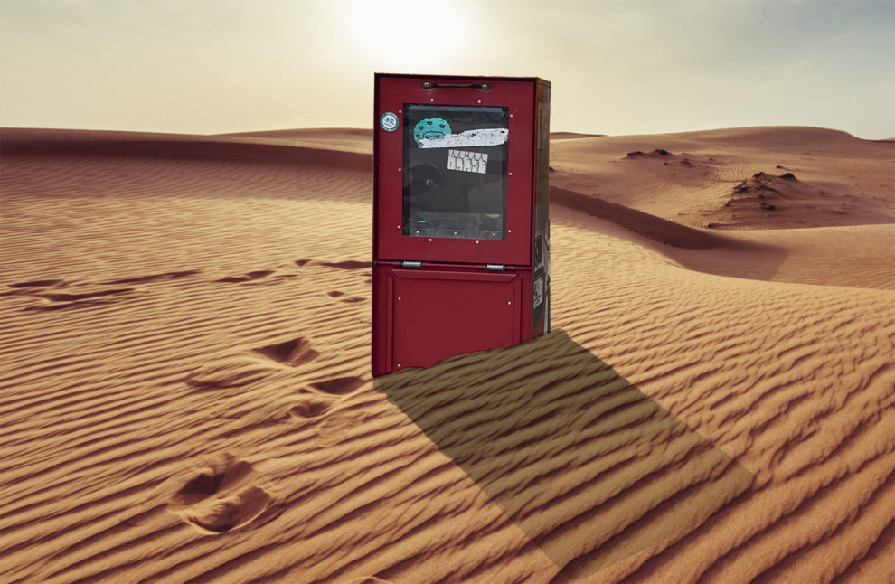 A newspaper box is seen in a desert in this photo illustration.