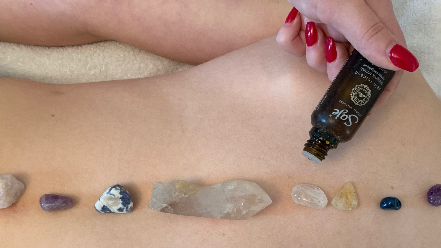 Re-enactment of a crystal aromatherapy massage, a treatment that involves essential oils (aromatherapy) and crystals that are advertised to balance energies in the body.