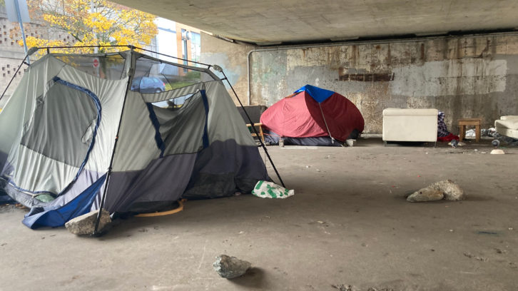 Tents set under the Cogswell Interchange near downtown Halifax.
