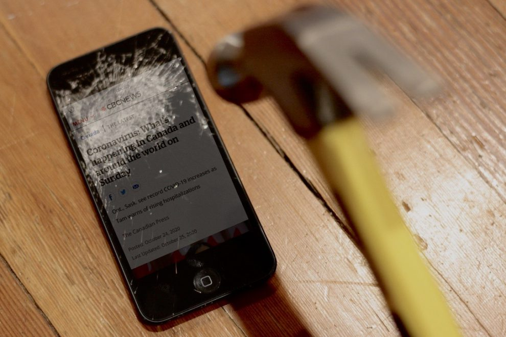 A cellphone gets smashed in this photo illustration.