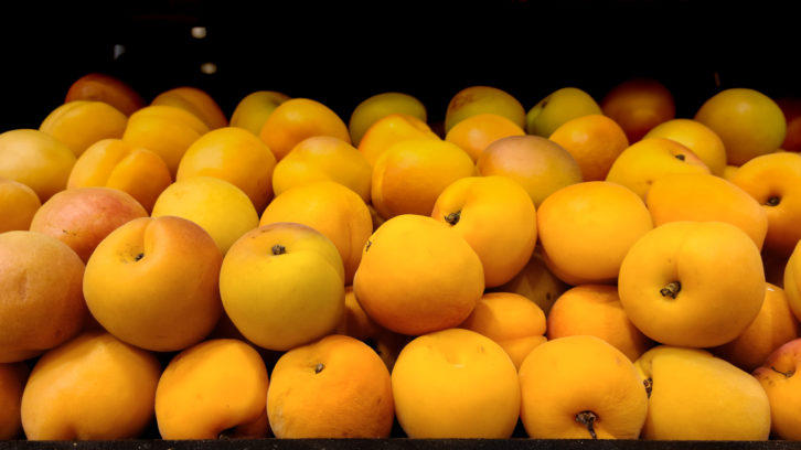 Loose apricots sit on a grocer's shelf in St. John's.