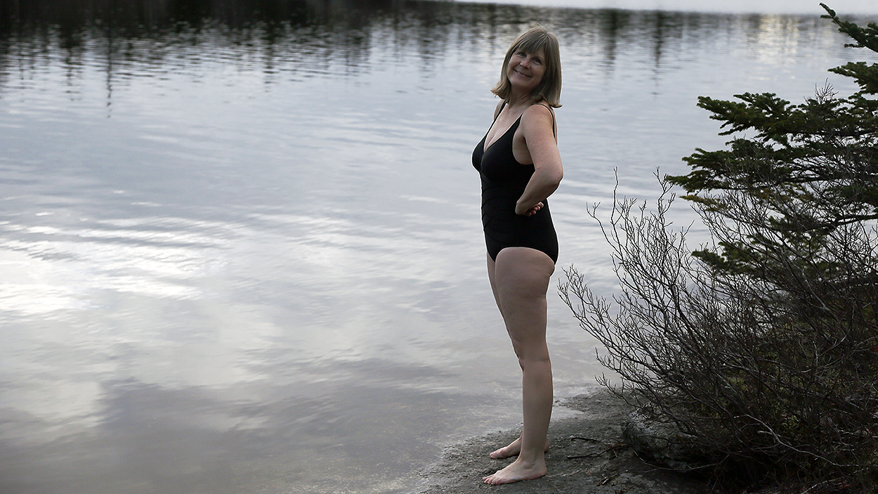 Kelly Loxdale poses before diving into Frederick Lake in Hubley, N.S., on Dec. 9.