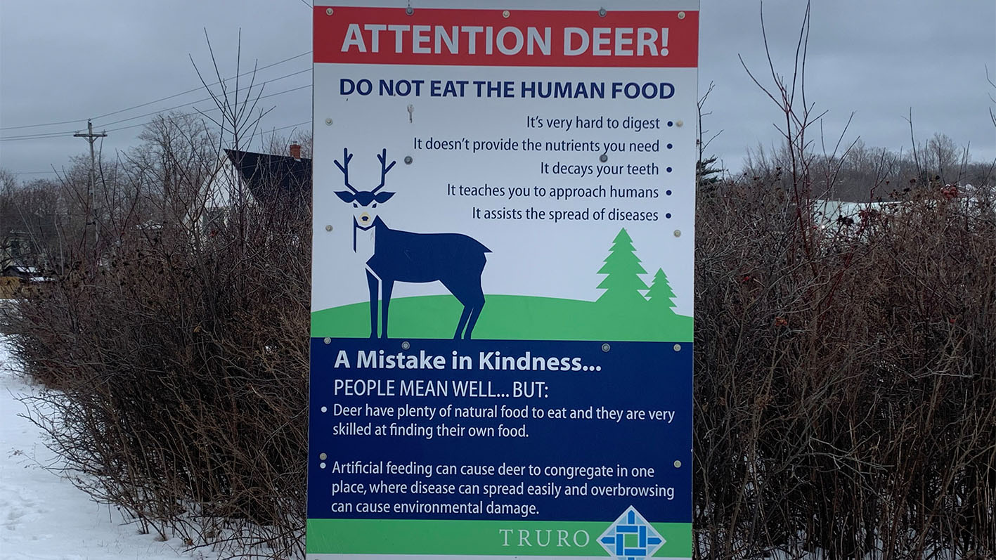This sign advises deer to not eat human food, as it's a dangerous mistake in kindness.