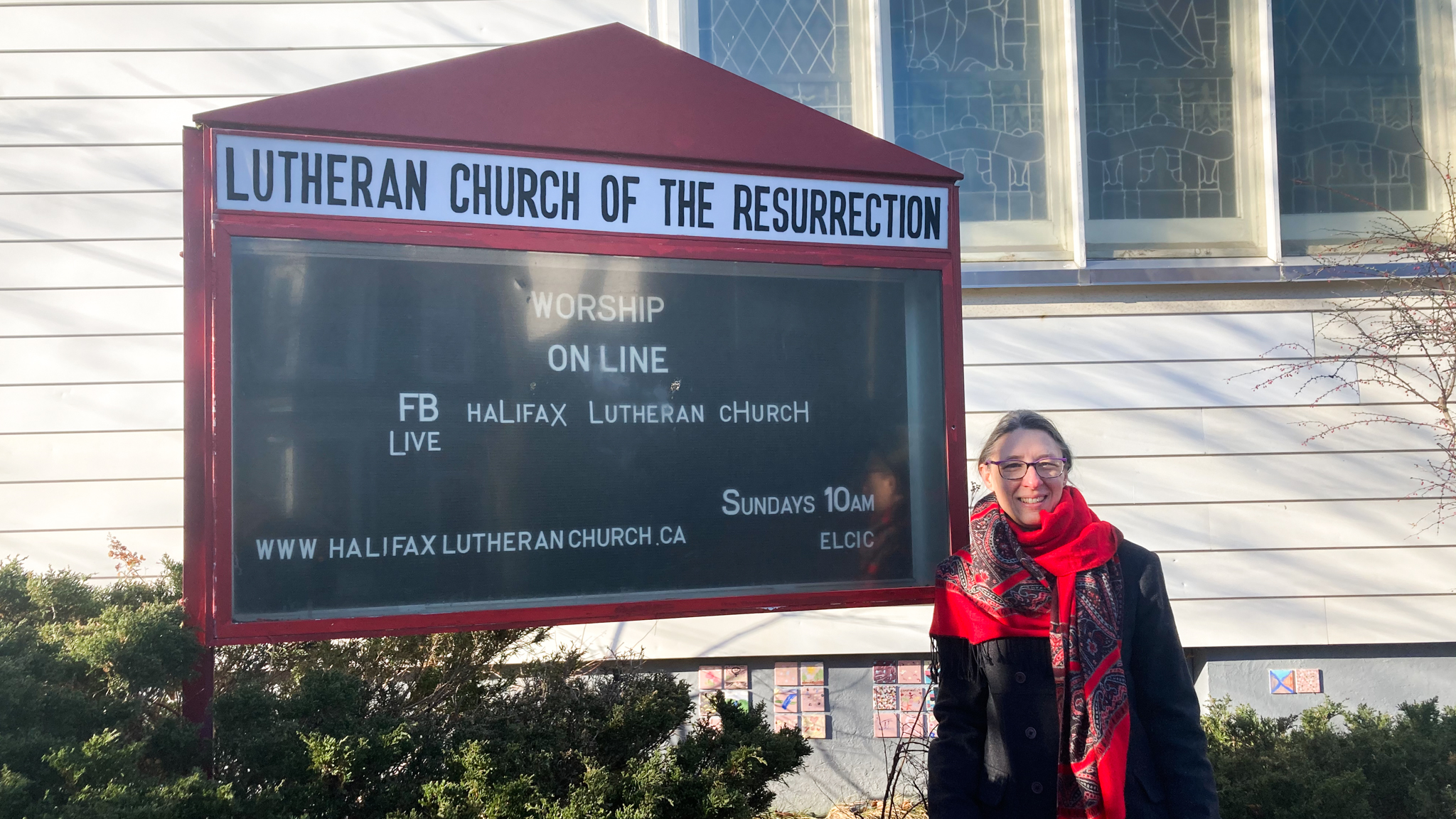 Pastor Kimberlynn McNabb  in front of the Lutheran Church of the Resurrection.