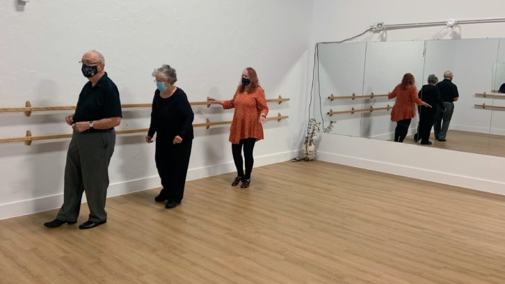 Instructor Cheryl Ewing shows students John and Donna McDermott some choreography at a DanceABLE class at Edgett Dance & Wellness in Halifax.