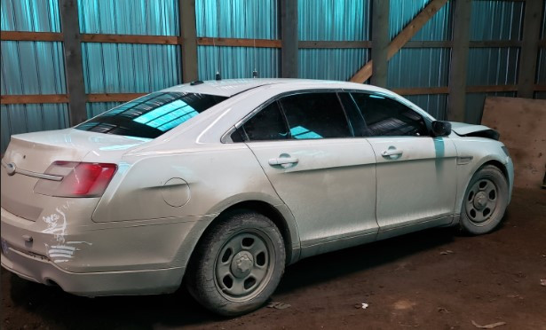 The suspect's 2013 Ford Taurus he allegedly used as an unmarked police car.