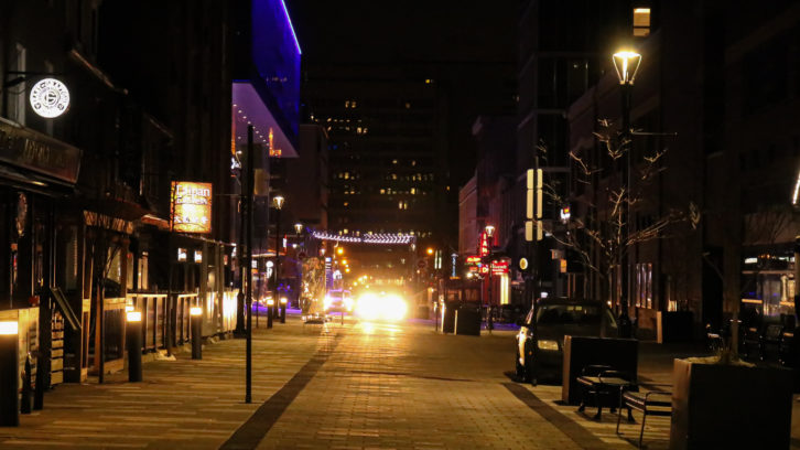 A quiet and empty Friday night on Argyle street. Every two to five minutes, a cab drives by.