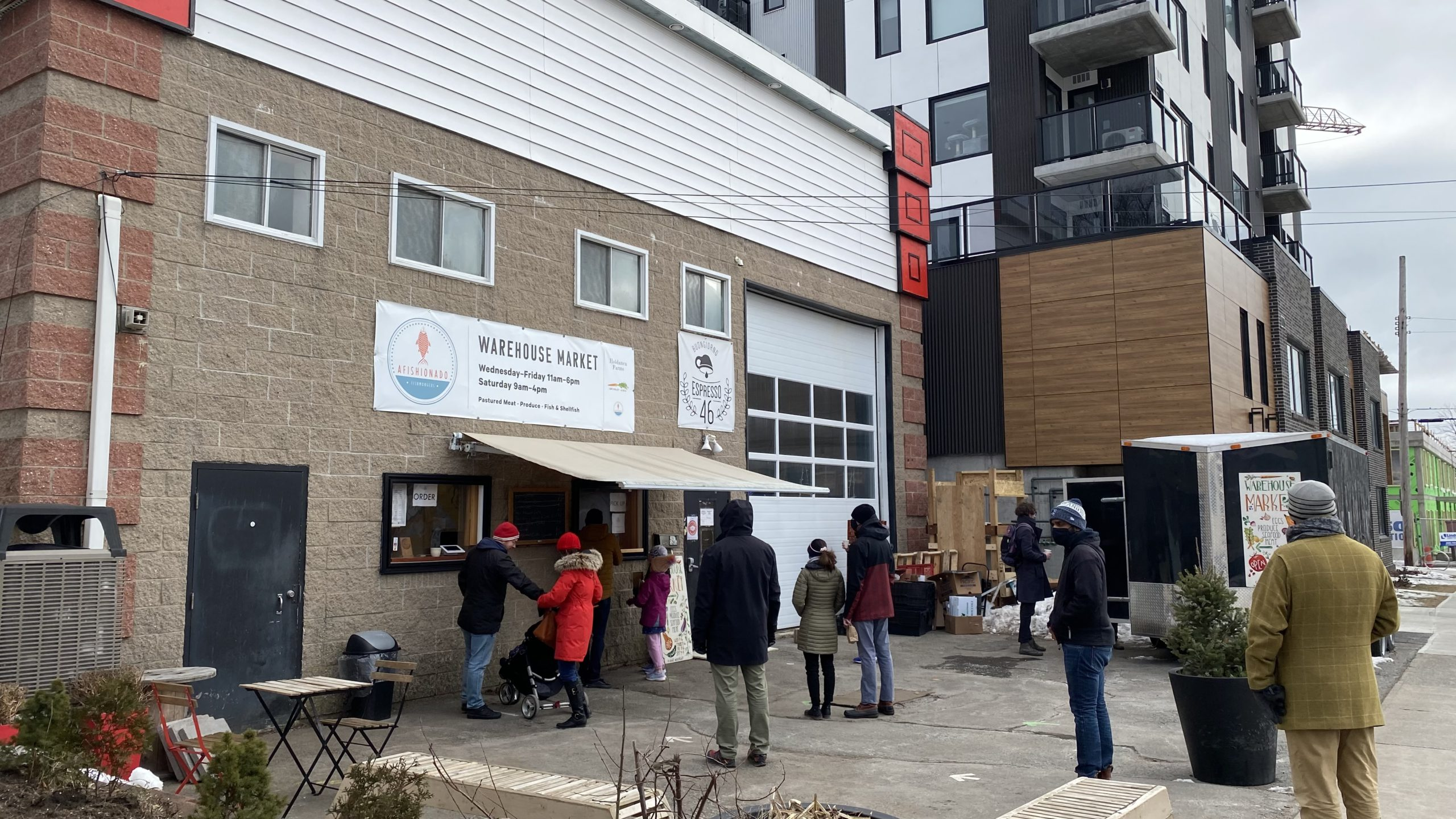 A socially-distanced crowd gathers at Warehouse Market on Saturday, January 30th.