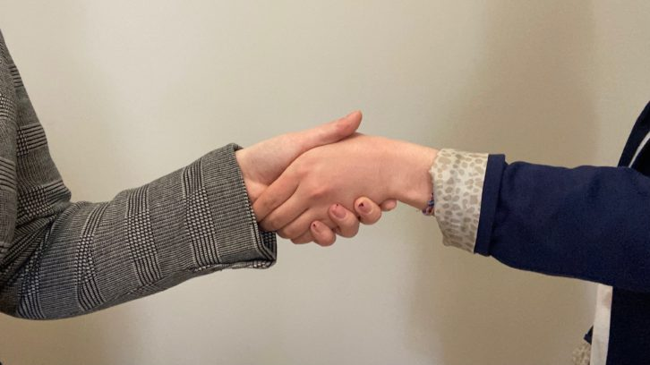 Photo illustration of two women shaking hands. Women-led Sandpiper Ventures received a $5-million contribution from the Nova Scotia government last Friday.