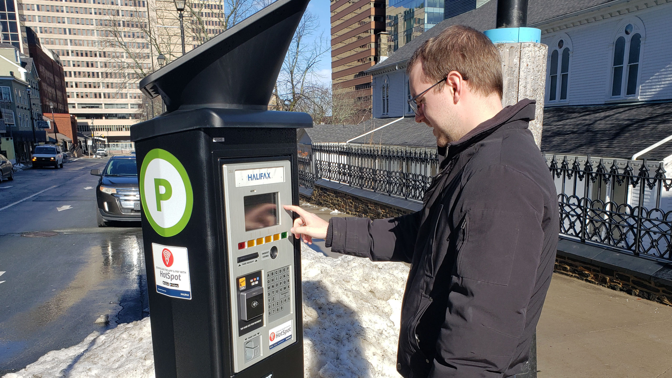 A man uses one of the digital parking stations in downtown Halifax on Feb. 3, 2020.