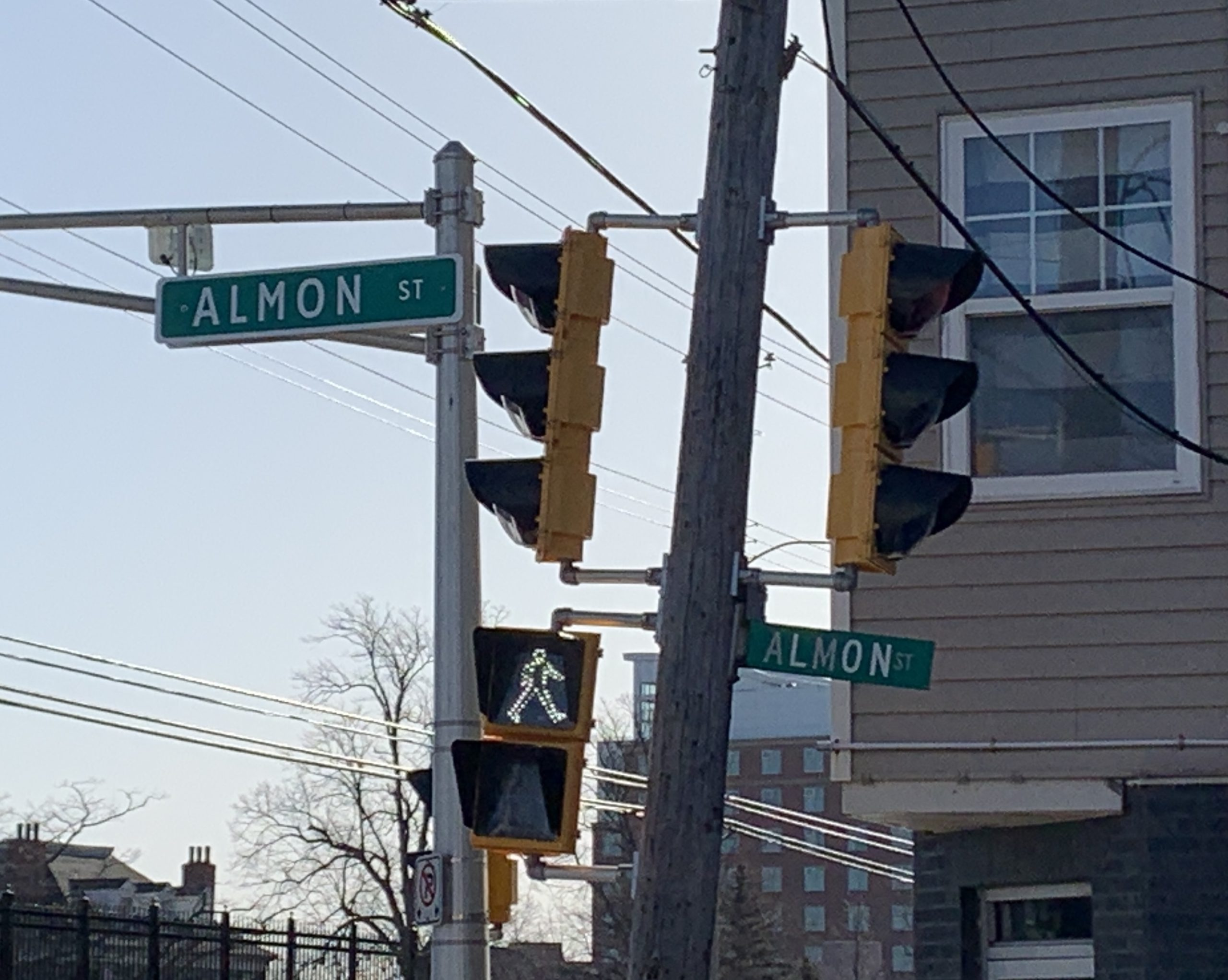 The two signs for Almon Street at its junction with Gottingen Street are a perfect illustration of the difference in effectiveness of both styles of signs. The oversized sign is larger and is mounted over the roadway, while the smaller sign is farther off to the side and harder to read while driving.