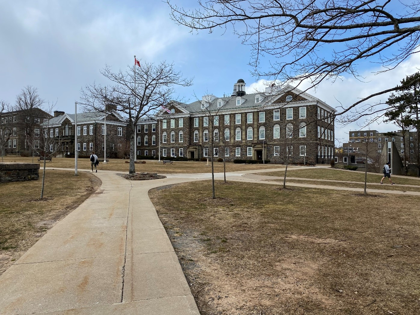 Students stroll through Dalhousie University's quiet campus on South Street, Halifax NS, on March 14, 2021. The once bustling campus has been left mostly deserted by online learning.