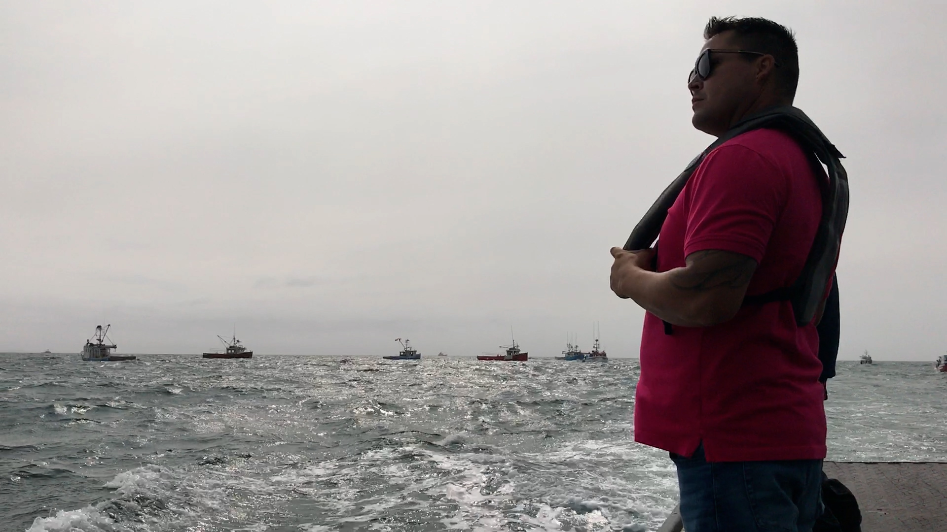 Brandon Maloney keeps an eye on commercial fishing boats as Mi'kmaw fishers exercise their treaty right to fish for a moderate livelihood.